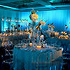 Soft lighting and unique floral centerpieces for Miami event