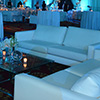 Professional event designers transform space into sprawling luxurious venue with atmospheric lighting